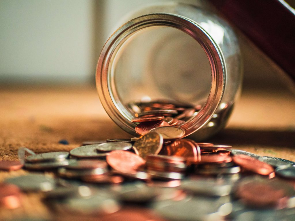 money pouring from a jar, how to negotiate your salary to your satisfaction